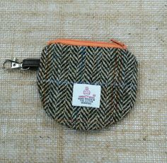 Hey, I found this really awesome Etsy listing at https://www.etsy.com/uk/listing/463101461/handmade-genuine-harris-tweed-coin-purse
