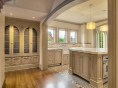 Love the archways with the molding trim! An the fabulous builtin cabinets for added china storage.