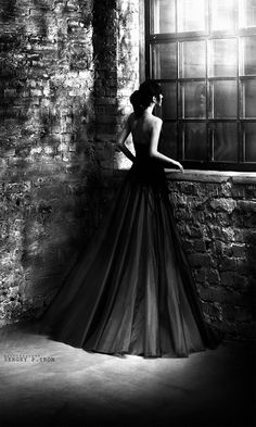 black and white photography . window . beautiful gown