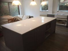 This is the Carrera quartz. It is a white premium quartz with a marble appearance throughout. Carrara Quartz, White Quartz, Carrera, Kitchen Island, Marble, Dining Table, Furniture, Home Decor, Island Kitchen