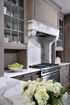 Interesting marble hood Peter Block Caseworks - Stunning kitchen with grey wash kitchen cabinets and marble slab countertops Painting Kitchen Cabinets, Kitchen Paint, Kitchen And Bath, New Kitchen, Kitchen Dining, Kitchen Decor, Kitchen Mantle, Taupe Kitchen, Decorating Kitchen