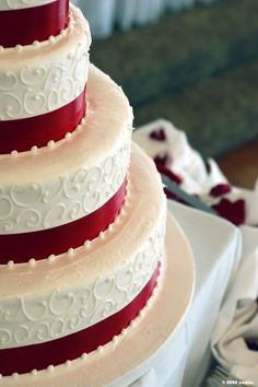 beautiful wedding cake with red accents