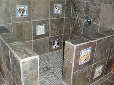 The absolute BEST little shower built in a mud room.....easiest way to wash or spray those muddy paws~