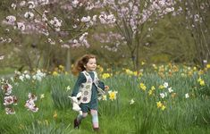 Eve, age 3, plays among spring blooms ahead of the Easter Festival at Kew Gardens in west London, on March 30, 2017.