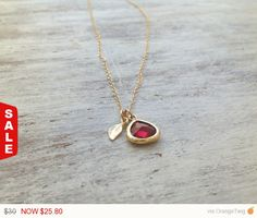 Spectacular necklace! Ruby Glass and Gold Framed Pendant pendant and a tiny gold leaf Together created a charming and unique look. Just lovely :)  Necklace Measures Approximately 17 Glass stone pendant 10mm  If you would like this chain altered, please convo me .   All my jewelry are packed in an elegant gift box. If you want to give it as a gift you can specify the address and Ill be happy to send it on your behalf.  To see more, please visit my shop at : http://www.etsy.com/shop/Avnis  I…