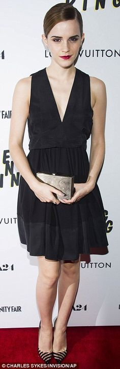 Keeping it simple: The 23-year-old wore striped pointy heels and accessorised with a dainty copper clutch