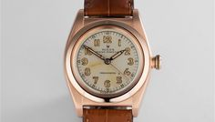 """This vintage rose gold """"Bubble Back"""" is simply drop dead gorgeous... Always rarer in rose gold, this early Rolex automatic is in superb condition and was fitted with a stunningly simple silver dial with Radium lume. Preserved with very little wear over the last 70 years, this Oyster Perpetual sat unused in its box for so long that the Radium lume in the hands has left a faint and characterful shadow at 8:27! A beautiful, rare and wearable vintage Rolex. Two year warranty."""