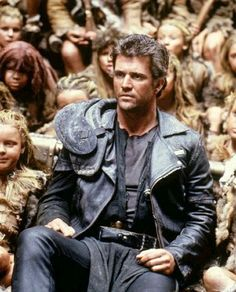 Mel Gibson - Mad Max: Beyond Thunderdome 1985 (the 8 year olds in the background… Mad Max Mel Gibson, Mad Max 3, Cars Movie Characters, Fantasy Characters, Movie Stars, Movie Tv, Film Science Fiction, The Road Warriors, Post Apocalyptic Fashion