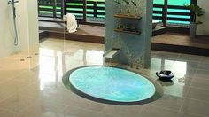 Small Bathroom Design with Ultra Modern Tub and Glass Shower Stall