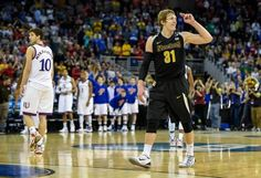 Wichita State Shockers guard Ron Baker (31) saluted the Wichita State fans at the final buzzer of their 78-65 victory over the Kansas Jayhawks during the third round of the NCAA men's basketball tournament on March 22, 2015, at CenturyLink Center in Omaha, Neb.