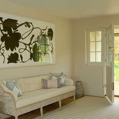 Cream hallway with wood sofa | Hallway decorating
