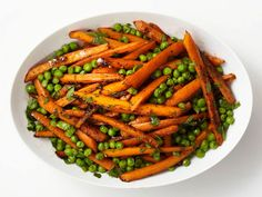 Roasted Carrots and Peas from FoodNetwork.com.  The spice mixture of the cumin, ginger, and coriander really sounds amazing. Can't wait to try.