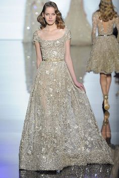 Cap sleeve wedding gown with embellishements by Zuhair Murad.