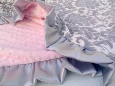 Hey, I found this really awesome Etsy listing at http://www.etsy.com/listing/61274003/pink-and-gray-damask-minky-baby-blanket