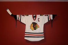 Cute way to display a jersey.  Would look cute above the boys beds.