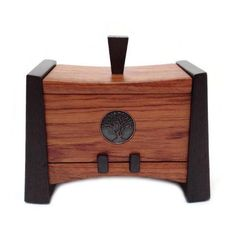 """Crafted from Bubinga and Wenge and accented with a Bronze Tree design inlay. This lift off lid box measures approximately 7"""" wide and 6.25"""" tall"""