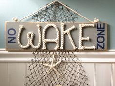 Distressed No Wake Zone sign -nautical nursery sign - beach nursery sign nursery decor - nautical rope sign - no wake nursery wood sign These distressed plank style signs are made using scraps of cotton rope...what a charming addition to your nautical and beach themed nursery! Each sign measures approx 20x5 inches, has a distressed painted finish and would make a wonderful baby shower gift! A knotted rope hanger has been added to the top. This listing is for 1 sign. Use the drop down menu…