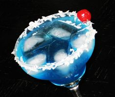 Blue Coconut : 1,5 oz. Malibu Coconut Rum, 1.5 oz. Maui Blue Hawaiian Schnapps, 4 oz. 7-Up, 1 Tbsp. Cream of Coconut, Shredded Coconut, Cherry for garnish : Invert a chilled Margarita glass, and rub the rim in a saucer containing the Cream of Coconut.  Then, tap the rim in some shredded Coconut.  Once done, set the glass upright and fill with ice.  Add the Rum, Schnapps, 7-Up, and give it a gentle stir.  Garnish with a Cherry.