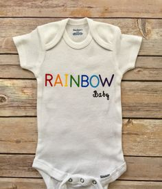 A personal favorite from my Etsy shop https://www.etsy.com/listing/522276003/rainbow-baby-onesie-newborn-outfit-baby