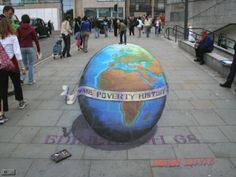 """""""This Make Poverty History drawing was requested by Live8 to support the pressure campaign on the G8 in Edinburgh."""" -  Julian Beever is an English chalk artist who has been creating trompe-l'œil chalk drawings on pavement surfaces since the mid-1990s. He uses a projection technique called anamorphosis to create the illusion of three dimensions when viewed from the correct angle. (Wikipedia: https://en.wikipedia.org/wiki/Julian_Beever) - Website: http://www.julianbeever.net/globe.html"""