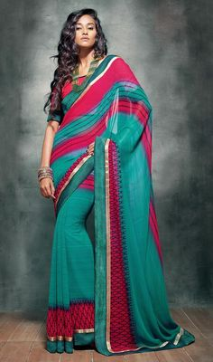 Trendy fuchsia and sea green embroidered georgette sari is a casual sari which is beautified with block print, woven lace and silk thread embroidered border which adds charm and grace to your beauty. Sari comes with matching stitched blouse as shown in the picture. #PrintedDesignCasualSaree
