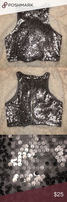 Sequin Crop Top A high collar sequin tank crop with racer back. Sequins are sewn onto a mesh paneling with another piece of fabric as lining. No missing or loose sequins, no snags, no tarnishing of sequins or zipper. When worn, sits about 2 inches above my belly button. Express Tops Crop Tops