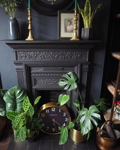 Cast iron fireplace styling with plants and gold candleholder. Cast Iron Fireplace Bedroom, Black Fireplace, Faux Fireplace, Living Room With Fireplace, Fireplace Ideas, Victorian Bedroom, Victorian Fireplace, Victorian House, Chimney Decor