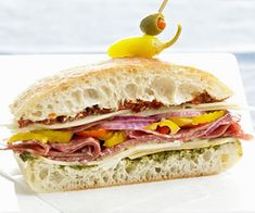 Also called a hoagie or sub, these popular sandwiches can be sliced for entertaining and easily toted to a tailgate or picnic in the park. Tote-and-Slice Loaf Sandwich Best Sandwich, Soup And Sandwich, Sandwich Recipes, Picnic Recipes, Sandwich Loaf, Tailgating Recipes, Loaf Recipes, Cheesecake Recipes, Dinner Recipes