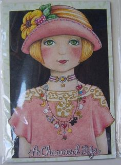 This is a magnet that was handcrafted using an original Mary Engelbreit illustration, it is NOT a copy or reproduction. I have been collecting