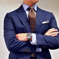 suitandtiefixation:Nothing like a good pinstriped suit, combined with an elegant double cuffed shirt and a nice tie