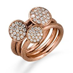This fabulous 18K rose ring is comprised of .65ctw round white Diamonds.    TR474- added to my wish list
