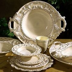 Searched so long for this only to find it WAY out of my price range....sigh.  Italian Baroque Dinnerware- Cream (20-piece) - Indeed Decor