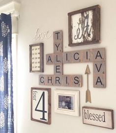 This is the perfect combination of things I've wanted on a wall!! Scrabble letters, family dates, photos, love