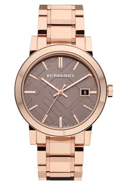 This shiny rose gold bracelet watch finishes off a business outfit nicely.