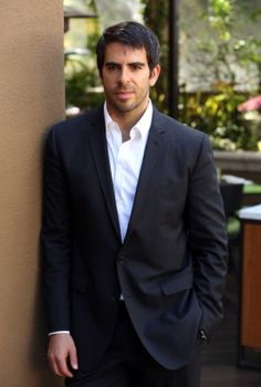 Eli Roth leaning against a wall at IFTA.