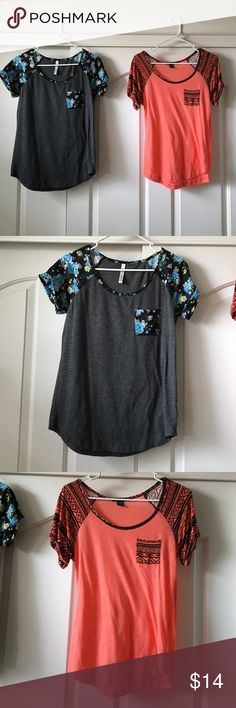 Shirt bundle💕 Two shirts/blouses in great condition. Pocket detail in front. Floral and tribal patterns. Both size medium and both same style of shirt. Tops Tees - Short Sleeve
