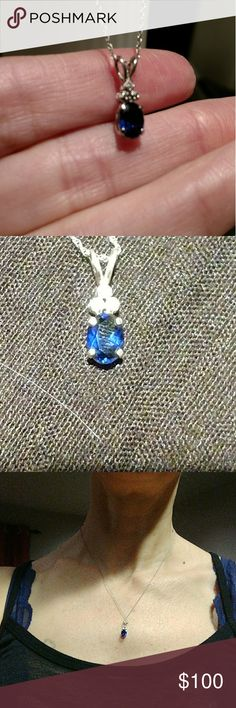 14 K white gold sapphire pendant This has never been worn before the pendant has 14 karat stamp on the inside of where the chain goes through the top of pendant.  there are three small diamonds positioned at the top of the sapphire. Please see all photos for full description and details Jewelry Necklaces