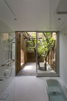 wet room with amazing sunken bath . .I love the outdoors feel of an Ensuite