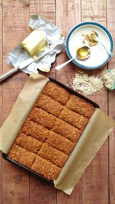 Ginger and coconut flapjacks - easy to make chewy oat bars flavoured with ginger and coconut. The perfect energy boosting sweet treat. Tray Bake Recipes, Baking Recipes, Cookie Recipes, Dessert Recipes, Drink Recipes, Oat Bars, Granola Bars, Coconut Recipes, Biscuit Recipe