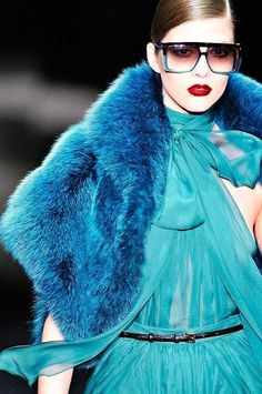 Gucci - another incredible blue outfit. Glasses and lips set it off. Fur, chiffon, high neck, bow. Wow.
