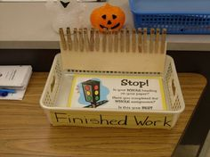 """""""Finished Work"""" system. Students flip their clothespin to the smiley face side when they submit completed work."""