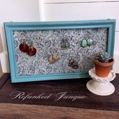 Jewelry organizer made from an old frame.