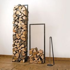 This Raumgestalt - Woodtower is a stunning way to keep wood in a small space and keep it stylish!