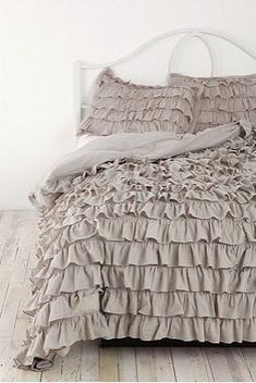 I am in love with this gorgeous bedding from Urban Outfitters!  It comes in ivory, gray, petal pink, and yellow.  Twin and double/queen sizes, around $150.