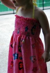 Bandana Dress Tutorial. Make a dress that's both easy to make and easy on the wallet with the Bandana Dress Tutorial. All you need are a couple of cute bandanas to make this DIY dress for your little girl. A shirred top and ribbon halter makes it comfy and cute! #sewing