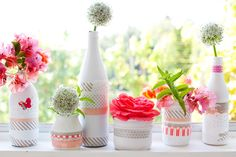 dressing up white spray painted glass bottles with a little washi tape and a couple paper doilies. Nothing fancy, just apply the tape and doily pieces here and there. cut a few flowers and sprigs from my garden and instantly a windowsill or a table is prettied up for a get together.
