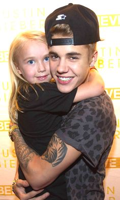 Justin with a fan on a Meet & Greet.