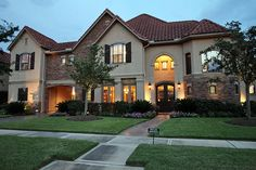 Beautiful View of Home at Dusk is Situated in a Gated Enclave of Riverstone.