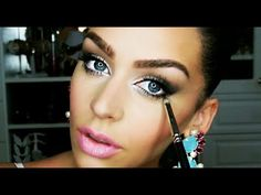 I sooo love her!!Her name is Carli Bybel. Subscribe to her channel on You Tube! Every tutorial she does is awesome! Adorable smokey eye tutorial <3