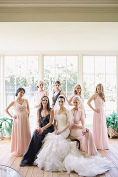 All kinds of fierce! Bridesmaids wearing Ceremony by Joanna August (pink, grey and white dresses) and bride in Vera Wang